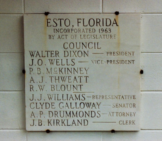 A plaque on the Esto Town Hall commemorates the town's rebirth in 1963.